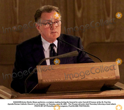 Carroll OConnor Photo - K22223MRActor Martin Sheen performs a scripture reading during the funeral for actor Carroll OConnor at the St Paul the Apostle Roman Catholic Church in Los Angeles  on Tuesday June 26 2001  The 76-year-old actor died Thursday following a heart attack PHOTO BY AP PhotoDamian Dovarganes PoolGLOBE PHOTOSINC
