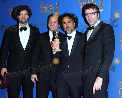 Alexander Dinelaris Photo - (l-r) Writer Armando Bo Writer Alexander Dinelaris Writerdirector Alejandro Gonzalez Inarritu and Writer Nicolas Giacobone Pose in the Press Room During the 72nd Annual Golden Globe Awards Held at the Beverly Hilton Hotel on January 11 2015 in Beverly Hillscalifornia UsaphotoleopoldGlobephotos
