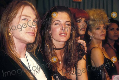 Axl Rose Photo - Axl Rose with Stefanie Seymour at Look of the Year 09-03-1991 A7977 Photo by Adam Scull-Globe Photos Inc