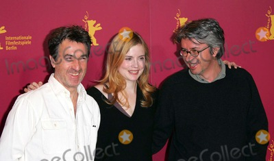 Isabelle Carre Photo - Francois Cluzet Isabelle Carre  Christian Vincent attends the Photocall For Four Stars Berlin Film Festival 02-11-2006 Credit Allstar-Globe Photos Inc