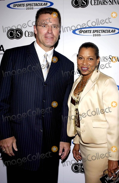 Howie Long Photo - PETE CARROLL JERRY RICE AND JOHN WOODEN WERE HONORED TH THE CEDARS-SINAI MEDICAL CENTERS 20TH ANNUAL  SPORTS  SPECTACULAR HELD SUNDAY AT THE CENTURY PLAZA HOTEL IN CENTURY CITY  THE EVENT BRINGS TOGETHER THE GREATEST NAMES IN SPORTS TO JOIN  THEIR PEERS IN HELPING CHILDREN WITH BIRTH DEFECTSK43677VGPHOTO VALERIE GOODLOE  GLOBE PHOTOS INC  2005HOWIE LONG AND ROLONDA WATTS06-12-2005