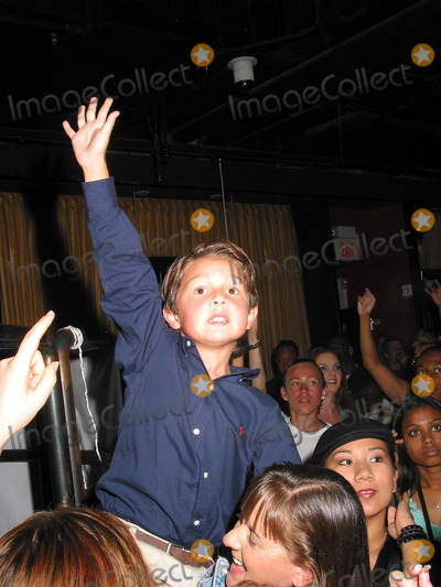 Mitch Holleman Photo - SD 080902 13 Years Old Actress Scarlett Pomers(tv-series Reba) Performing at Club One Sevenhighland  Hollywood in Hollywoodca (08092002) Mitch Holleman (He Is Playing in Reba Brother to Scarlett Pomers) Photomilan RybaGlobe Photos 2002 (D)