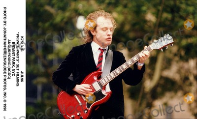 Angus Young Photo - Jul96 Private Parts Set Filming Bryant Park NYC Angus Young (Acdc) Photo by Jonathan GreenGlobe Photos Inc