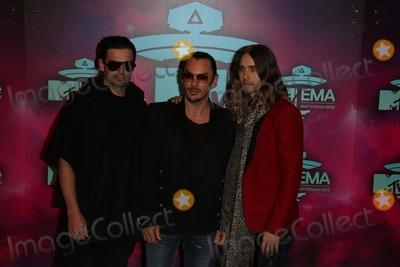 Thirty Seconds to Mars Photo - Tomo Milicevic (l-r) Shannon Leto and Jared Leto of Thirty Seconds to Mars Arrive at the 2013 Mtv Emas Aka Mtv Europe Music Awards at Ziggo Dome in Amsterdam Netherlands on 10 November 2013 Photo Alec Michael