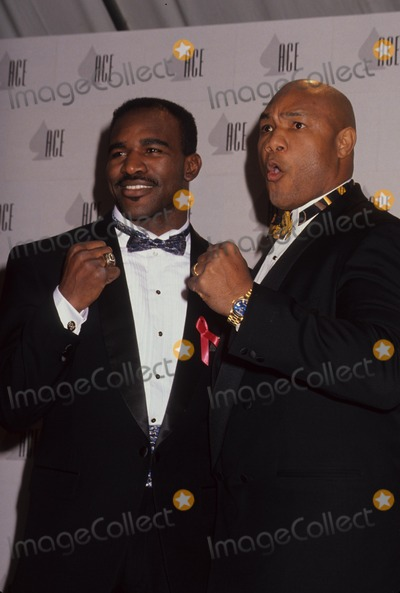 George Foreman Photo - Evander Holyfield with George Foreman Photo by Michael Ferguson-Globe Photos Inc