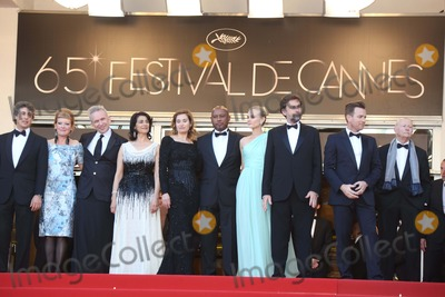 Hiam Abbass Photo - Jury Members Director Alexander Payne (l-r) Director Andrea Arnold  Fashion Designer Jean-paul Gautie Actress Hiam Abbass Actress Emmanuelle Devos Director Raoul Peck Actress Diane Kruger President of the Jury Director Nanni Moretti Actor Ewan Mcgregor and President of the Cannes Film Festival Gilles Jacob Arrive at the Opening of the 65th Cannes Film Festival at Palais Des Festivals in Cannes France on 16 May 2012 Photo Alec Michael Photo by Alec Michael-Globe Photos Inc