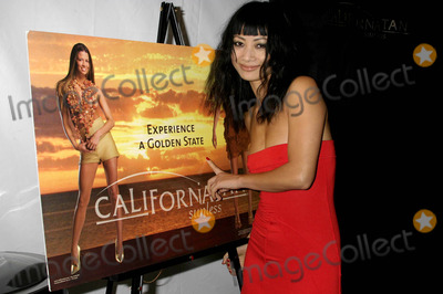 Ashley Paige Photo - Backstage at the Ashley Paige Springsummer Collection Show -Mercedes Benz Spring 2005 Fashion Week Smashbox Studios Culver City CA 10272004 Photo by Clinton H WallaceipolGlobe Photos Inc 2004 Bai Ling with California Tan Signage