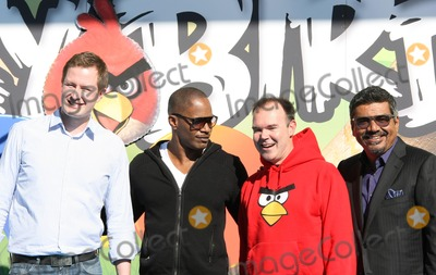 Angry Bird Photo - Niklas Hed Jamie Foxx Peter Vesterbacka George Lopez Actors and Creators of Angry Birds Game Rio Angry Birds Game Launch Century City Los Angeles 01-28-2011 photo by Graham Whitby Boot-allstar - Globe Photos Inc -Globe Photos  2010