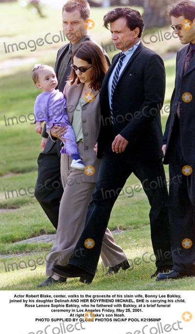 Bonnie Lee Bakley Photo - Actor Robert Blake center walks to the gravesite of his slain wife Bonny Lee Bakley joined by his daughter Delinah AND HER BOYFRIEND MICHAEL SHE is carrying his child Rose Lenore Sophie Bakley who he fathered with Bakley at a brief funeral ceremony in Los Angeles Friday May 25 2001  At right is Blakes son Noah Man at rear left is unidentified PHOTO SUPPLIED BY GLOBE PHOTOS INCAP POOL K21950NP