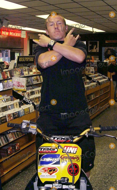 Mike Metzger Photo - CALEB WYATT -FREESTYLE MOTOCROSS SUPER HEROES MIKE METZGER AND CALEB WYATT SIGN AUTOGRAPHS FOR THE RELEASE OF THEIR ACTION PACKED STORY BEHIND THE ULITMATE FREESTYLE MOTOCROSS MANEUVER ENTITLED FLIPPED OUT -TOWER RECORDS WEST HOLLYWOOD CA -08122003 -PHOTO BY NINA PROMMERGLOBE PHOTOS INC2003 K32183NP