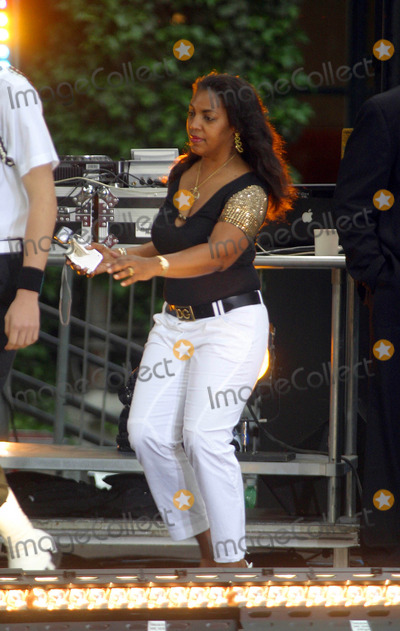 Tina Douglas Photo - Ashanti with Special Guest Ja Rule Performing on Abcs Good Morning America Concert Series at Bryant Park  New York City 06-06-2008 Photo by Bruce Cotler-Globe Photos Inc Tina Douglas ( Ashantis Mom with Video Camera )