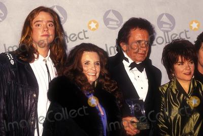Johnny Cash Photo - Grammy Legends Tribute 05-12-1990 Johnny Cash and Family Photo by Michael Ferguson-Globe Photos