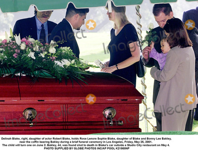 Bonnie Lee Bakley Photo - Delinah Blake right daughter of actor Robert Blake holds Rose Lenore Sophie Blake daughter of Blake and Bonny Lee Bakley near the coffin bearing Bakley during a brief funeral ceremony in Los Angeles Friday May 25 2001  The child will turn one on June 2 Bakley 44 was found shot to death in Blakes car outside a Studio City restaurant on May 4  PHOTO SUPPLIED BY GLOBE PHOTOS INCAP POOL K21950NP