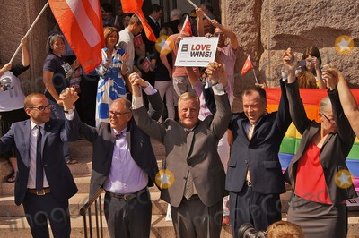 Jim Obergefell Photo - Approximately 150 People Gathered on the North Steps of the Texas State Capitol on 06292015 to Support the Recent Supreme Court Ruling on Gay Marriage and to Protest Recent Statements by Texas State Attorney Ken Paxton and Governor Greg Abbott That Wedding Officials in Texas Could Refuse to Perform Ceremonies For Same Sex Couples If They Held Religious Objectionparticipants Celebrate a Succesful Rallyl-rchad Griffinjim Obergefellmark Pharissvic Holmesrebecca Robertsonphoto by Jeff J NewmanGlobe Photos