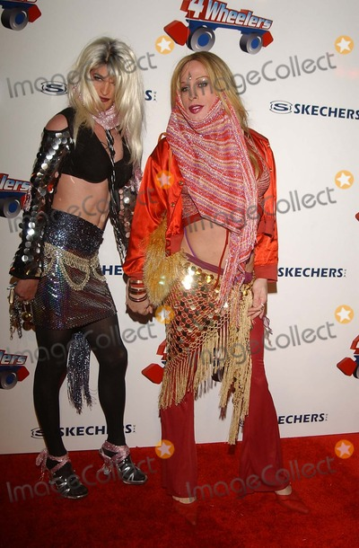 Alexis Arquette Photo -  4 Wheelers by Sketchers a Roller Disco-moroccan Style Debuting the Exclusive 4 Wheelers Design by Tracey Ross Hollywood Pladium Hollywood CA 04182002 Alexis Arquette and Candy Ass Photo by Amy GravesGlobe Photosinc2002 (D)