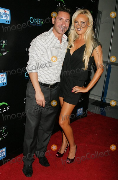 Todd Michael Krim Photo - Reality Cares Leap Foundation Benefit Hosted by Bridget Marquardt Sunstyle Tanning Studio West Hollywood California 08-06-2009 Todd Michael Krim-(reality Cares Founder) and Bridget Marquardt Photo Clinton H Wallace-photomundo-Globe Photos Inc