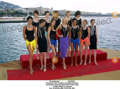 Adriana Karembeu Photo - Amfarjpg 1652001 Photocall with Models Including Adriana Karembeu Wearing Diamonds to the Value of 25 Million in Cannes All StarGlobe Photos Inc