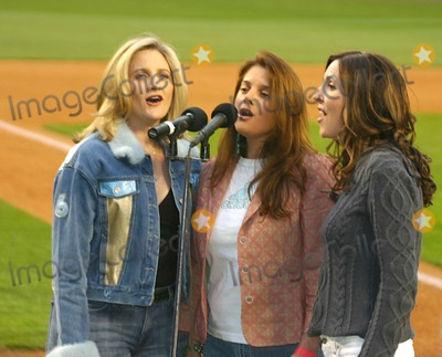 ALEX WITT Photo - Msnbcs Alex Witt Joins the Music Group Mrs Robinson Singing the National Anthem at the  Mets Vs Phillies  Game at Shea Stadium in Queens New York City 5-4-2005 Photo Bywilliam Regan-Globe Photos Inc