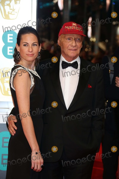 Niki Lauda Photo - Niki Lauda and Birgit Lauda Arrive at the 66th Annual British Academy Film Awards Aka Ee British Academy Film Awards Aka Baftas at Royal Opera House in London Great Britain on 16 February 2014 Photo Alec Michael