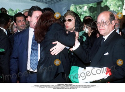 As Yet Photo - IMAPRESS PH  BENITO  CLEMOTFUNERAL OF PRINCESS LEILA PAHLAVI IN PARIS 16TH JUNE 2001 IN TOTAL BEREAVEMENT THE EX-EMPRESS OF IRAN FARAH PAHLAVI BURIED HER DAUGHTER IN THE PASSY CEMETERY IN PARIS LEILA PAHLAVI 31 PASSED AWAY A WEEK AGO IN LONDON THE OFFICIAL COMMUNIQUE WRITTEN BY HER MOTHER INDICATED THAT SHE PASSED AWAY IN HER SLEEP BUT THE EXACT CIRCUMSTANCES OF THE DEACEASED REMAIN AS YET UNKNOWNA HYSTERICAL ONLOOKER THROWS HERSELF INTO EMPRESS FARAHS ARMS BEFORE BEING LED OUT OF THE CEMETERYCREDIT IMAPRESSCLEMOTBENITOGLOBE PHOTOS INC