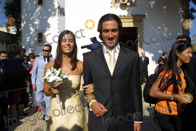 Hugo Viana Photo - 20030628 ALBUFEIRA PORTUGAL Hugo Viana and Raquel Gomes leaving Orada chapel in Albufeira Algarve after the religious ceremony The portuguese star of NewCastle 20 invited to the marriage only the family and some close friends as Beto ex-collegue from Sporting Raquel is natural from Armacao de Pera Algarve The honeymoon will be in MaldivasPHOTO CITYFILESGLOBE PHOTOS INCK31480