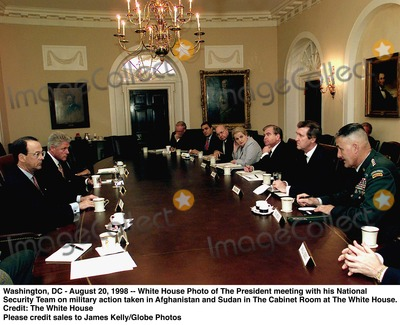 Richard Clark Photo - Washington DC - August 20 1998 -- White House Photo of The President meeting with his National Security Team on military action taken in Afghanistan and Sudan in The Cabinet Room at The White House  (Left to Right) Erskine Bowles The Chief of Staff President Clinton Richard Clarke Special Assistant to the President and National Co-ordinator for Infrastructure Protection and Counter-terrorism The Director of Central Intelligence George Tenet The Undersecretary of State for Political Affairs Thomas Pickering Secretary of State Madeleine Albright Assistasnt to the President and National Security Advisor Sandy Berger The Secretary of Defense Richard Cohen and The Chairman of the Joint Chiefs of Staff Hugh SheltonCredit The White House