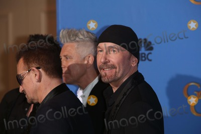 Adam Clayton Photo - Bono (l-r) Adam Clayton and the Edge of U2 Pose in the Press Room of the 71st Annual Golden Globe Awards Aka Golden Globes at Hotel Beverly Hilton in Los Angeles USA on 12 January 2014 Photo Alec Michael Photo by Alec Michael - Globe Photos Inc