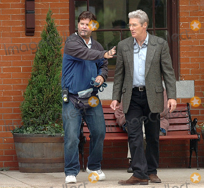 Train Photo - 06-05-2008 Photo by Ernest A Brown-Globe Photos Richard Gere right  is guided into position by a crew member as he gets ready to begin filming scenes for the movie Hachiko A Dogs Story in Woonsocket RI Thursday Gere is in town all week shooting scenes at the former Woonsocket train depotK58317EBEXCLUSIVE