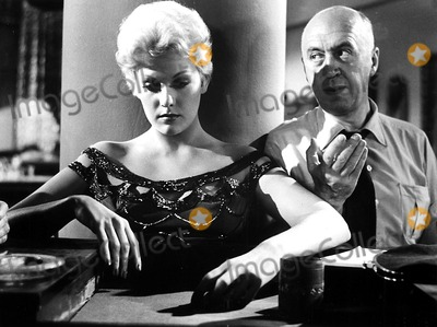 Kim Novak Photo - Kim Novak and Director Otto Preminger on the Set of the Man with the Golden Arm 1955 Supplied by Globe Photos Inc Kimnovakretro