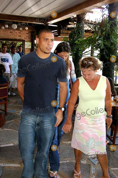 Daniela Cicarelli Photo - K41343RIO DE JANEIRO BRAZIL Ronaldo Real Madrid football player and his fiancee Daniela Cicarelli leaving Porcao Restaurant with his parents Ronaldo and Daniela are in Brazil to solve some family problems before their wedding next February 14 According to the players friends some Ronaldos relatives may have to arrange valid documentation to attend the couples marriage in Paris On the picture Ronaldo and her mother Sonia EXCLUSIVE01-30-2005PHOTO CLEOMIR TAVARESCITY FILESGLOBE PHOTOSINC