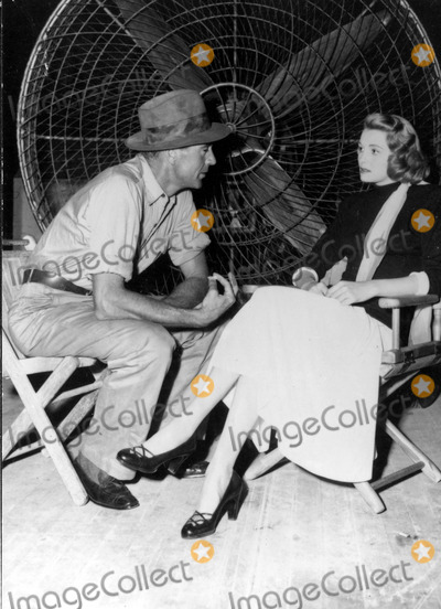 Gary Cooper Photo - Patricia Neal and Gary Cooper on the Set of Fountains Head 30030 Photo by Globe Photos Inc Patricianealretro