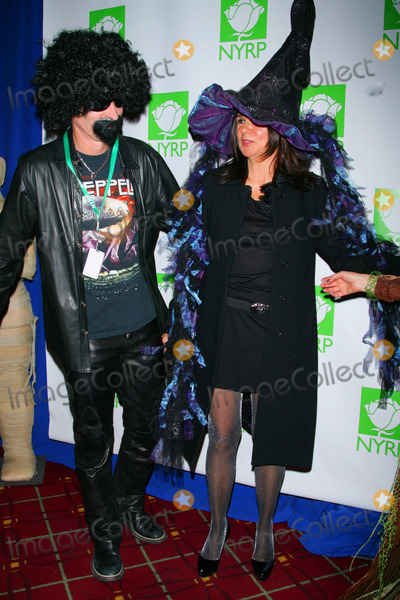 John McEnroe Photo - John Mcenroe and Wife Patty Smyth Arrive For Bette Midlers Hulaween Benefit Gala at the Waldorf Astoria Hotel in New York on October 29 2010 Photo by Sharon NeetlesGlobe Photos Inc