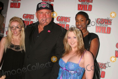 Sunny Lane Photo - Girls Gone Wild Magazine Launch Party Area West Hollywood California 04-22-2008 Dennis Hof-founder of the Moonlite Bunny Ranch with Sunny Lane (Far Right in Blue) and Guests Photo Clinton H Wallace-photomundo-Globe Photos Inc