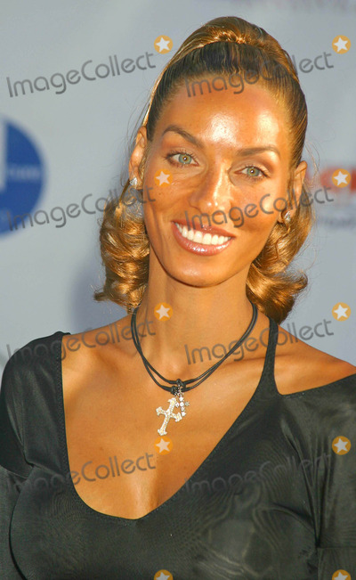 NICOLE MITCHELL Photo - 6th Annual Mercedes Benz Designcure at the Home of Sugar Ray Leonard in Pacific Palisades CA 07102004 Photo by Clinton H WallaceipolGlobe Photos Inc 2004 Nicole Mitchell-murphy