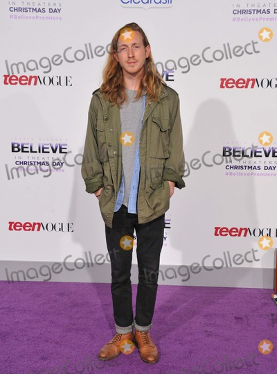 Asher Roth Photo - Asher Roth attending the World Premiere of Justin Biebers Believe Held at the Regal Cinemas LA Live in Los Angeles California on December 18 2013 Photo by D Long- Globe Photos Inc