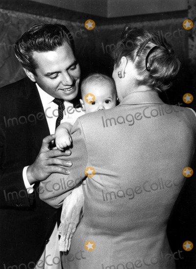 Desi Arnaz Photo - Lucille Ball and Desi Arnaz with Son Desi Jr on His Christening Day Supplied by Globe Photos Inc