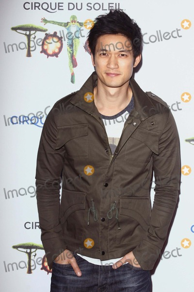 Harry Shum Jr Photo - Harry Shum Jr attends Totem From Cirque Du Soleil Santa Monica Opening on January 21st 2014 at Santa Monica Pier in Santa Monicacaliforniausa PhototleopoldGlobephotos