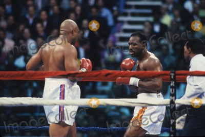 George Foreman Photo - Evander Holyfiel Vs George Foreman at Trump Plaza  Atlantic City 1991 L1387 Photo by John Barrett-Globe Photos Inc
