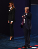 Photo - United States President Donald J Trump waves as he and his wife Melania Trump walk offstage after the first of three scheduled 90 minute presidential debates against Democratic presidential nominee Joe Biden in Cleveland Ohio on Tuesday September 29 2020 Credit Kevin Dietsch  Pool via CNPAdMedia