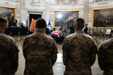 Photo - National Guard troops pay their respects as the late Officer William Billy Evans lies in honor in the Rotunda of the US Capitol in Washington DC on April 13th 2020Credit Anna Moneymaker  Pool via CNPAdMedia