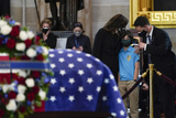 Photo - People pay their respects to slain US Capitol Police officer William Billy Evans as he lies in honor at the Capitol in Washington Tuesday April 13 2021 Credit Jacquelyn Martin  Pool via CNPAdMedia
