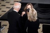 Photo - Democratic vice presidential candidate United States Senator Kamala Harris (Democrat of California) speaks to Democratic presidential candidate former US Vice President Joe Biden and his wife Dr Jill Biden prior to  for a ceremony to honor the late Justice Ruth Bader Ginsburg as she lies in state at National Statuary Hall in the US Capitol on Friday September 25 2020 Ginsburg died at the age of 87 on Sept 18th and is the first women to lie in state at the CapitolCredit Greg Nash  Pool via CNPAdMedia