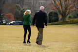 Photos From U.S. President Joe Biden and first lady Jill Biden walk on the South Lawn of the White House before boarding Marine One in Washington