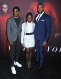 Photo - 19 March 2019 - New York New York - Yahya Abdul Mateen II Lupita Nyongo and Winston Duke at Universal Pictures US Premiere at the Museum of Modern Art in Midtown Photo Credit LJ FotosAdMedia