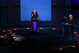 Photo - United States President Donald J Trump (C) and Democratic presidential nominee former United States Vice President Joe Biden (R) with Chris Wallace moderating face off in the first of three scheduled 90 minute presidential debates in Cleveland Ohio on Tuesday September 29 2020Credit Kevin Dietsch  Pool via CNPAdMedia
