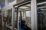Photos From Senate Majority Leader Mitch McConnell, R-KY, makes his way to wait for a train in the Senate subway.