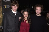 Photo -  Ashton Kutcher  Mila Kunis   Danny Masterson at the premiere of USA Films Traffic in Beverly Hills 12-14-00