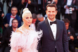 Photo - VENICE ITALY - AUGUST 31 Bradley Cooper and Lady Gaga walk the red carpet ahead of the A Star Is Born screening during the 75th Venice Film Festival at Sala Grande on August 31 2018 in Venice Italy(Photo by Laurent KoffelImageCollectcom)