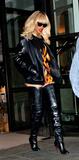 Rihanna,Christian Louboutin Photos - Rihanna leaves the Corinthia Hotel in London wearing Christian Louboutin thigh length leather boots London UK March 27 2012 London UKPicture Catchlight Media  Featureflash