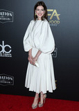 Photo - BEVERLY HILLS LOS ANGELES CA USA - NOVEMBER 04 Actress Anne Hathaway wearing a Valentino dress a Tyler Ellis clutch and jewelry from Anabela Chan and Kallati arrives at the 22nd Annual Hollywood Film Awards held at The Beverly Hilton Hotel on November 4 2018 in Beverly Hills Los Angeles California United States (Photo by Xavier CollinImage Press Agency)